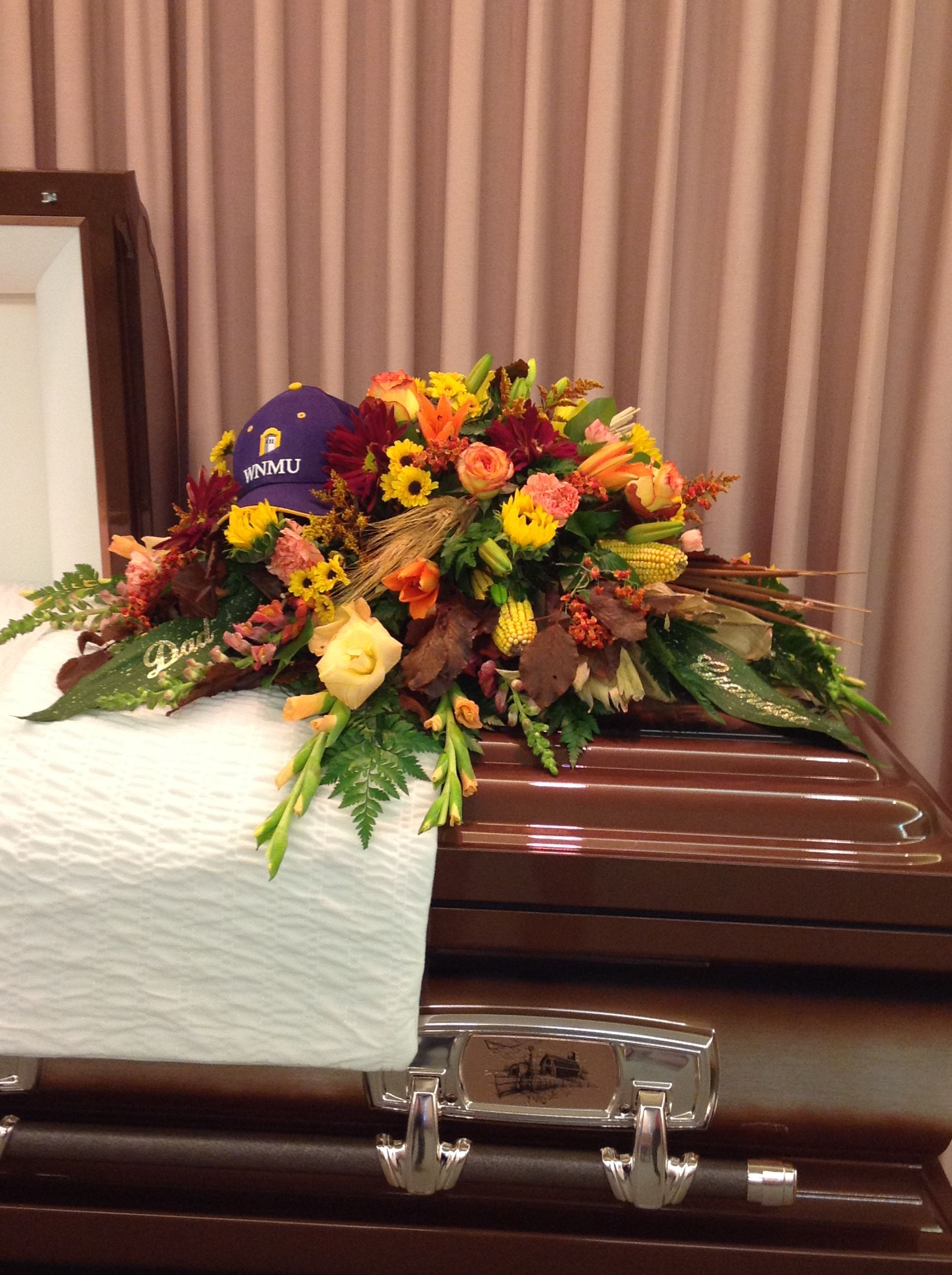 Fall flowers are just the right choice for a mans funeral added fall flowers are just the right choice for a mans funeral added touch of a personal cap of the farmer izmirmasajfo