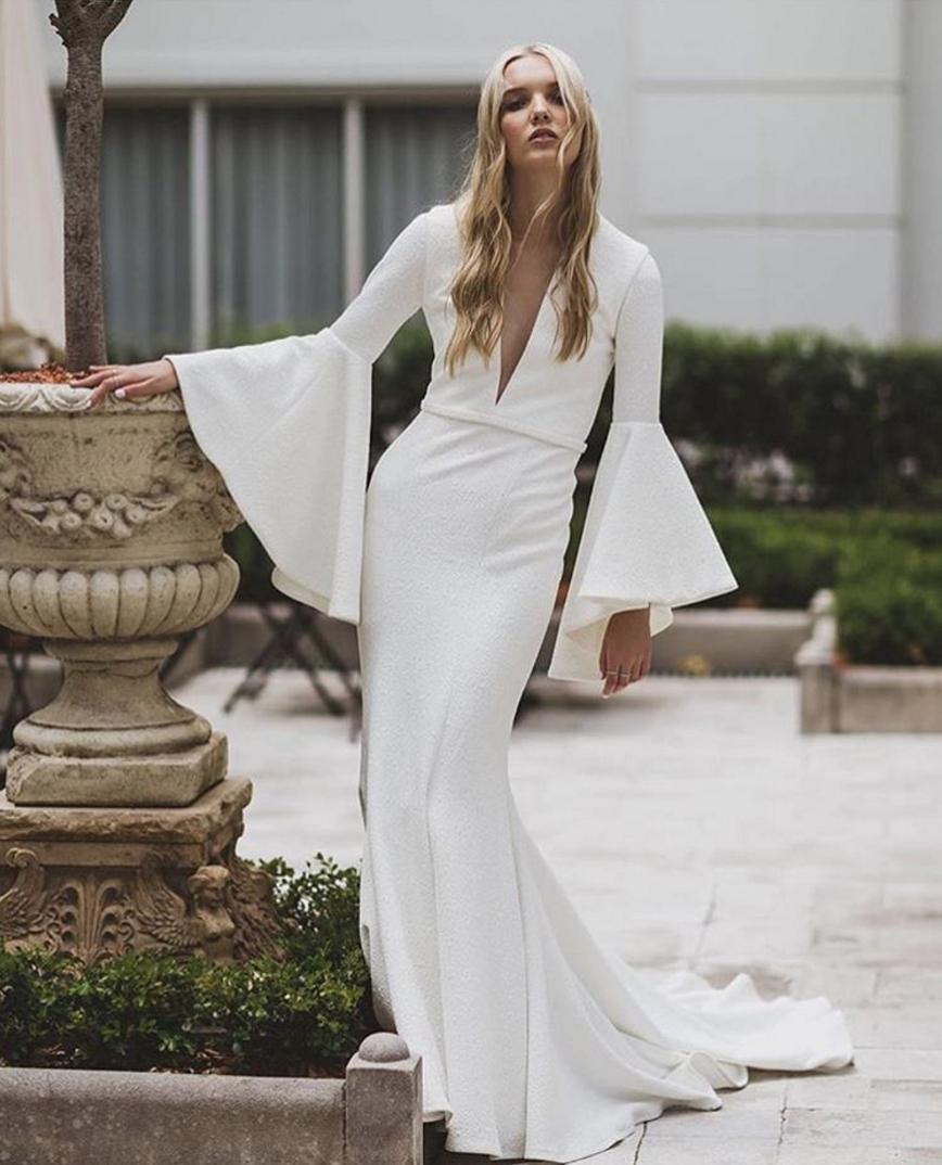 Sleek Wedding Gown With Bell Sleeves By Suzanne Harward Wedding Photography Janneke Wedding Dress Tulle Lace Modern Bridal Dress Alternative Wedding Dresses [ 1074 x 868 Pixel ]