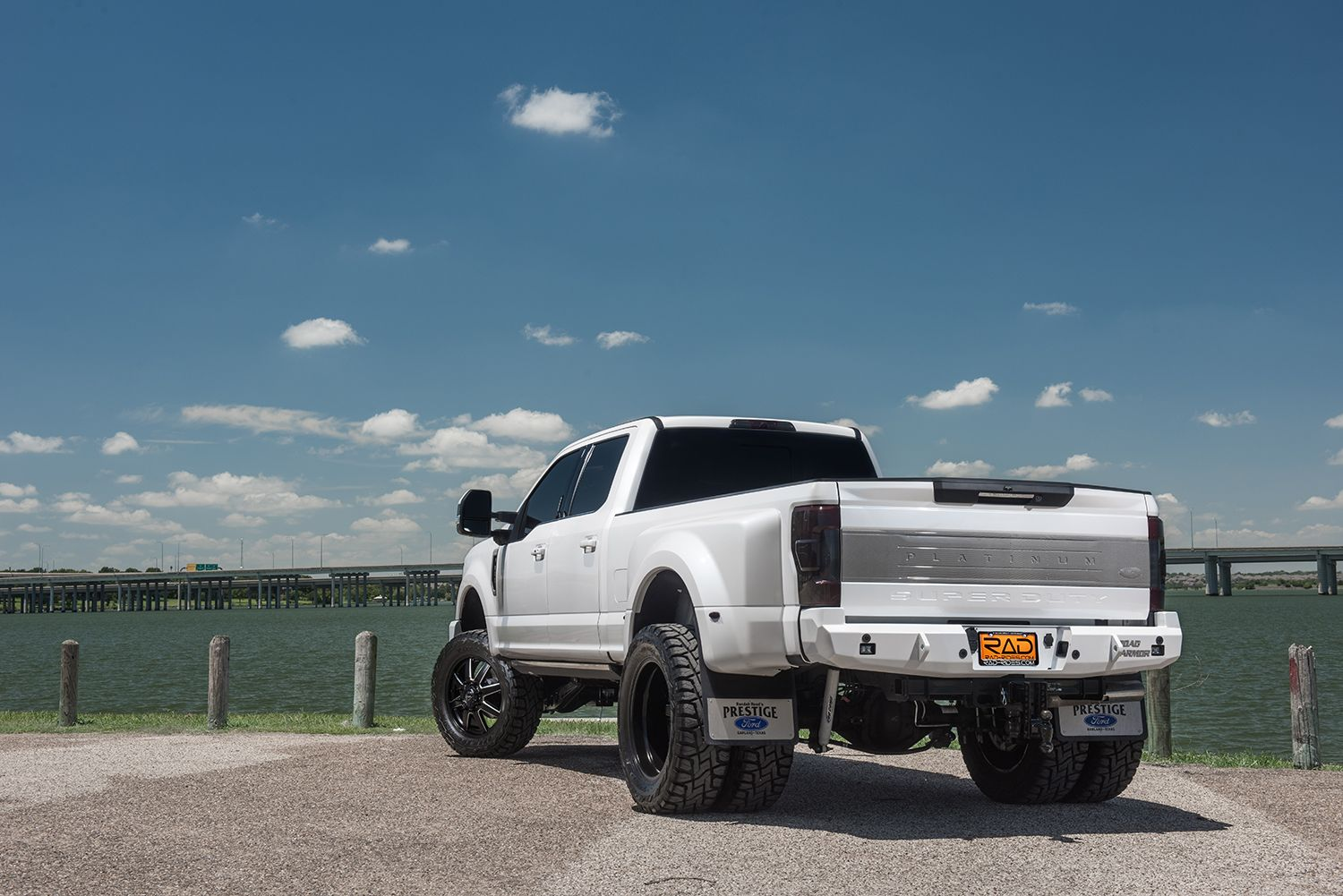 rear quarter ford f 350 super duty dually lifted in white