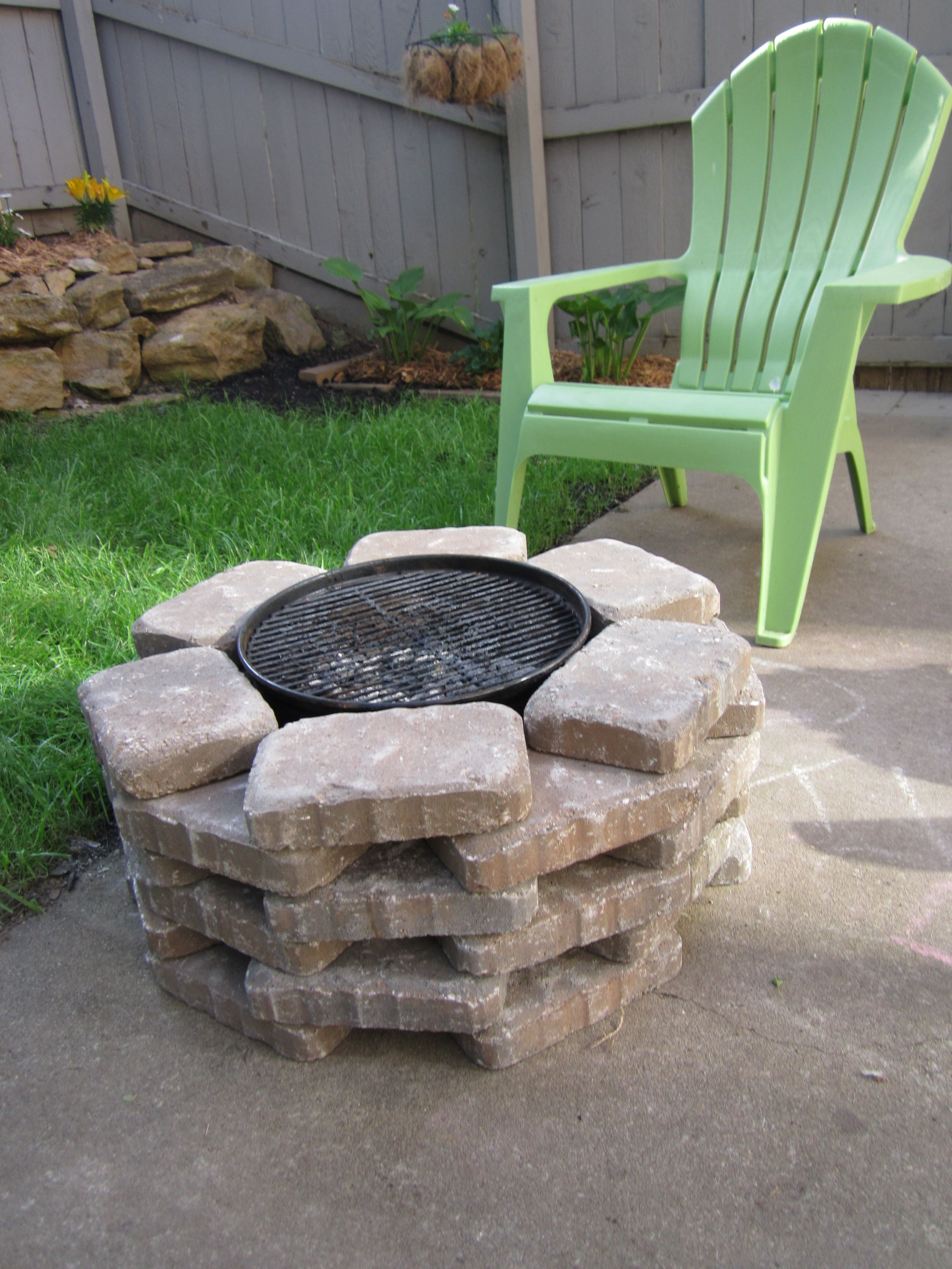 diy fire pit with the grill cover off so excited to enjoy our