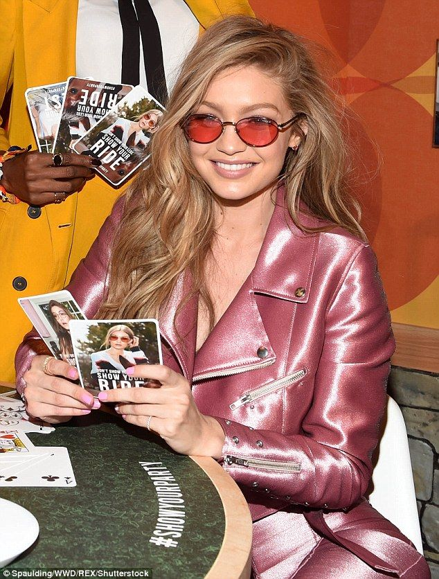 b0b7712fe4 Gigi Hadid dons shiny pink for the launch of her eyewear collection ...