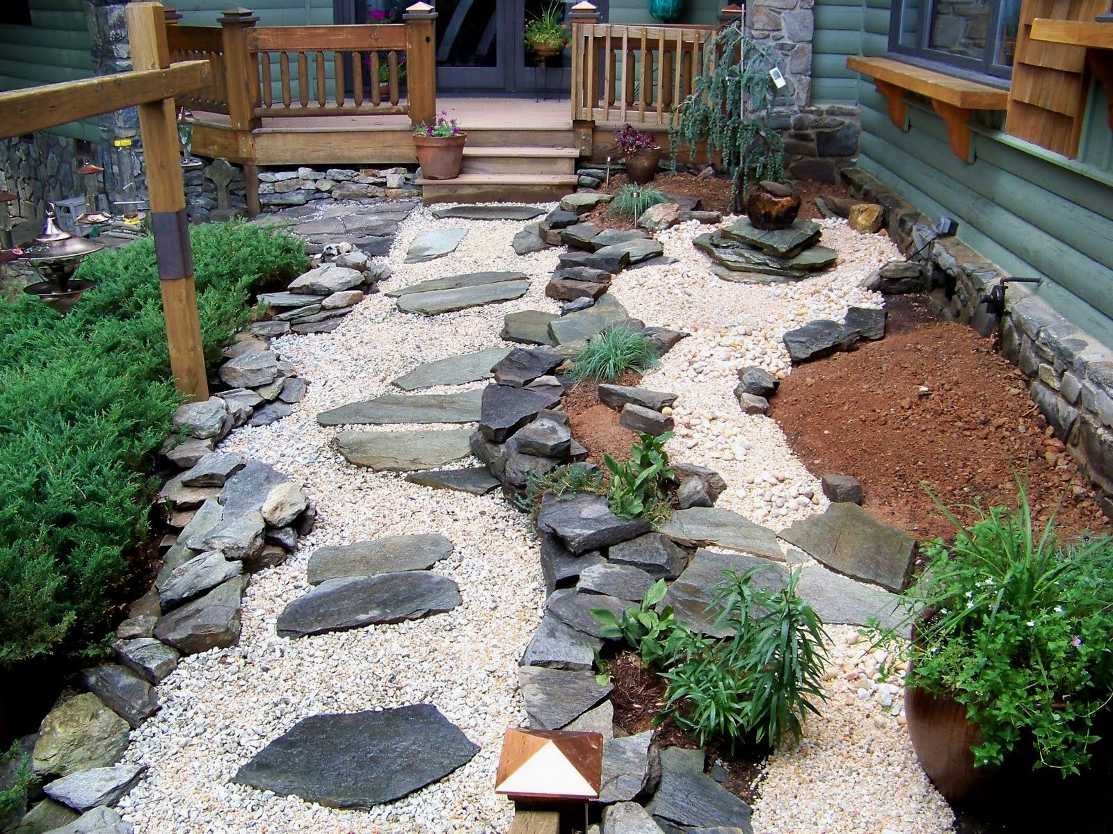 Luxurious Exterior House With Japanese Garden Design With Rock Also Small  Green Plants