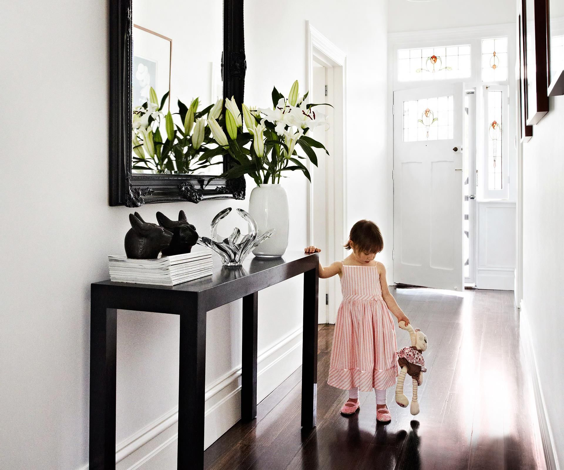 Declare your style the moment guests arrive by decorating entrances and hallways with thoughtful, personal and practical touches.