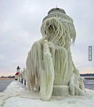 Frozen Lighthouse on Lake Michigan by echkbet