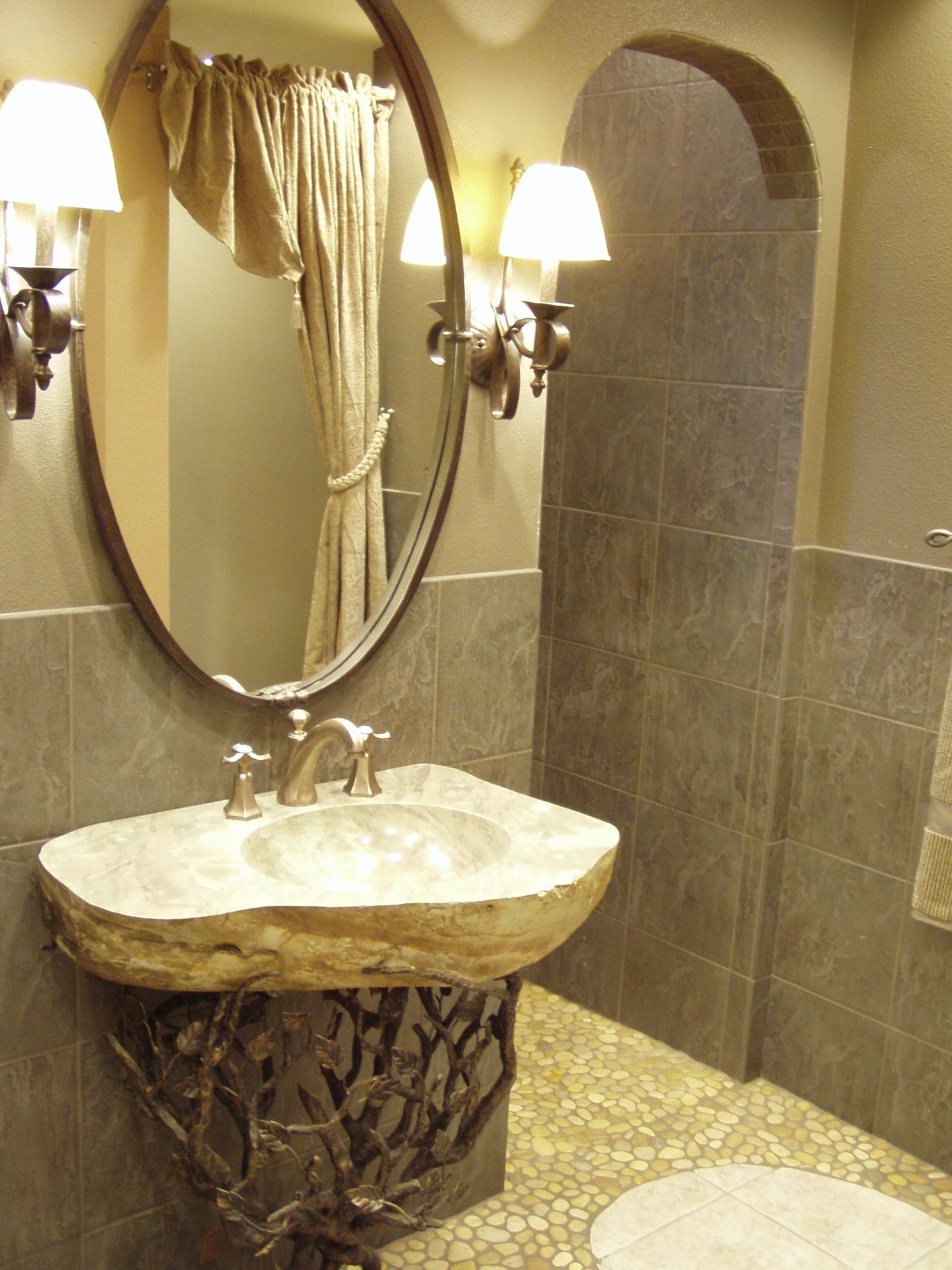 Doorless curbless tile shower with river rock floor in gray and