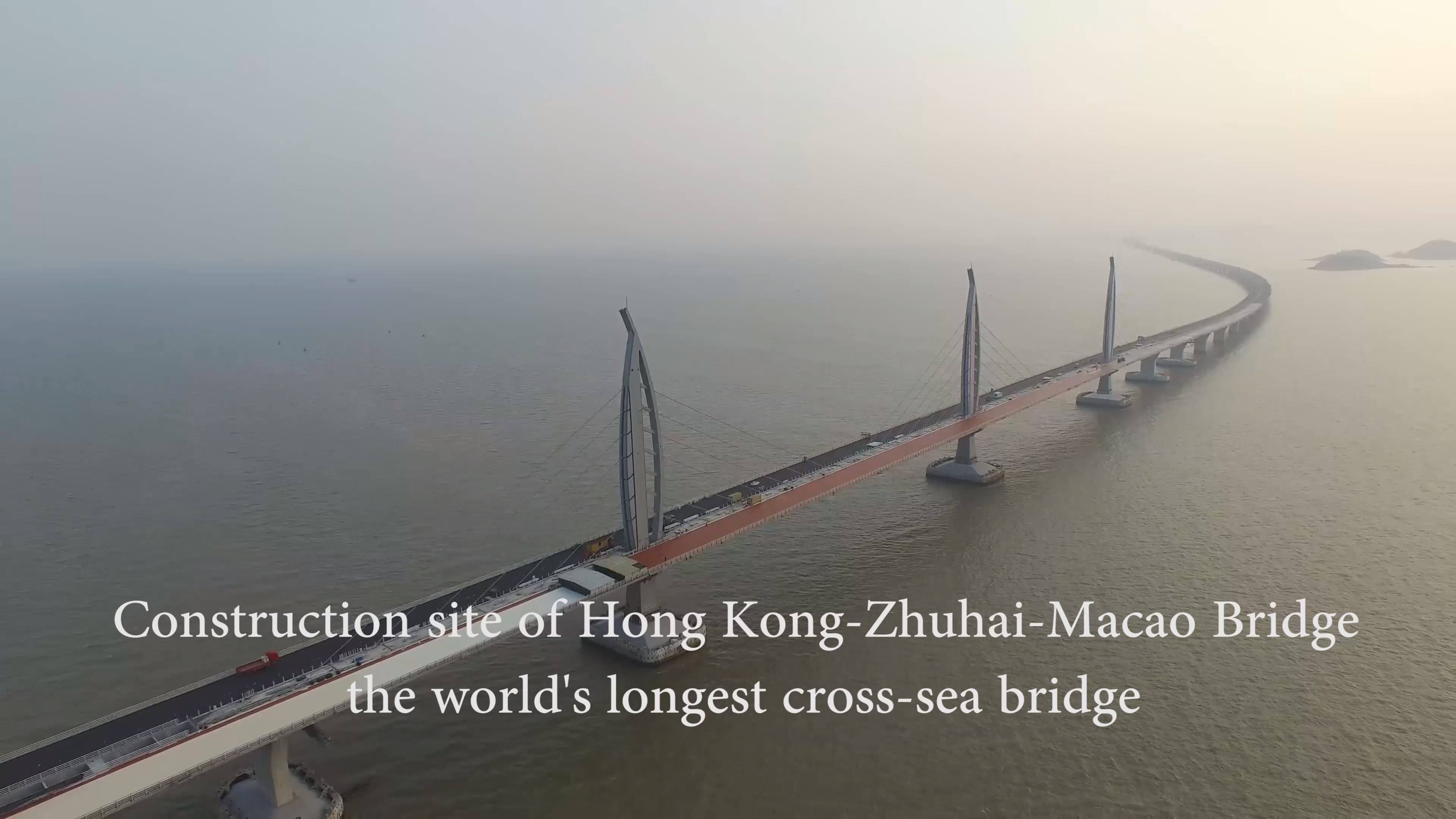 Key part of world's longest cross-sea bridge installed. More than 400,000 tonnes of steel have been consumed in a 6.7-km undersea tunnel and a 22.9-km bridge, enough to build 60 Eiffel Towers.   The Y-shaped bridge starts from Lantau Island in Hong Kong with branches to Zhuhai and Macao.   The bridge will cut travel time from Hong Kong to both Zhuhai and Macao from the current three hours on the road or one hour at sea to a mere half hour drive.