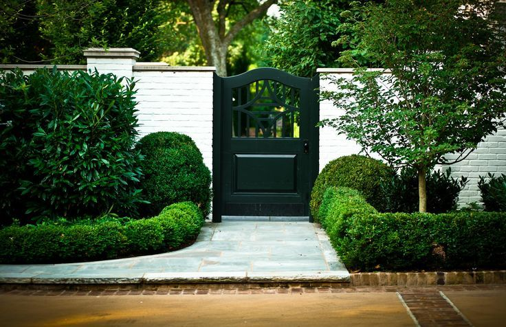 Outdoor Living As Simple As Black And White Painted Brick Walls Garden Gates Outdoor Inspirations