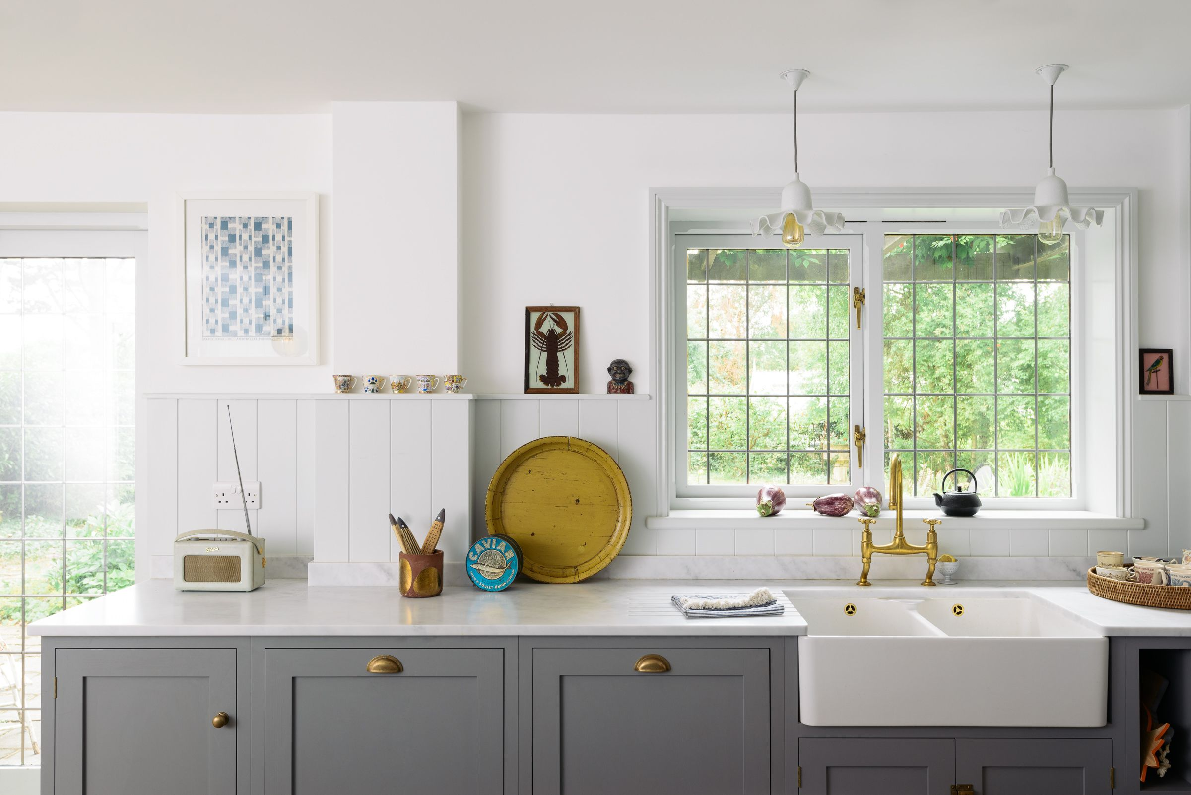 The Sink Run Features Grey Cupboards Pale Worktops A Double Belfast Sink And Brass Hardware Shaker Style Kitchen Cabinets Kitchen Design Decor Devol Kitchens