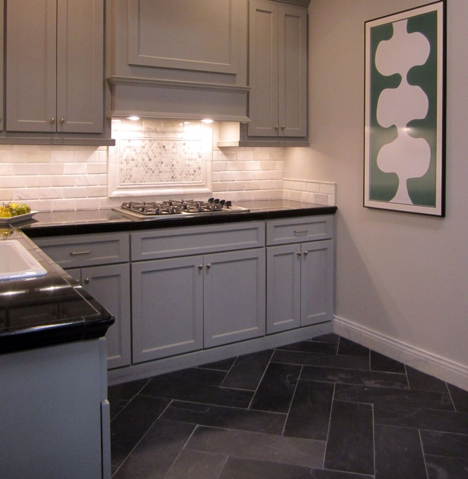 carrara marble backsplash with a herringbone pattern slate
