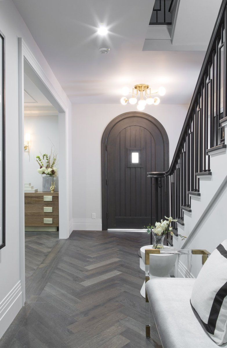 Home Decor And Lifestyle From Hello Lovely Studio Arched Door Herringbone Flooring Stunning Staircase In Entry Of Drew S Honeymoon House