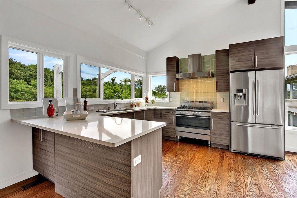Gorgeous kitchen with hardwood floors Desirable main level modern