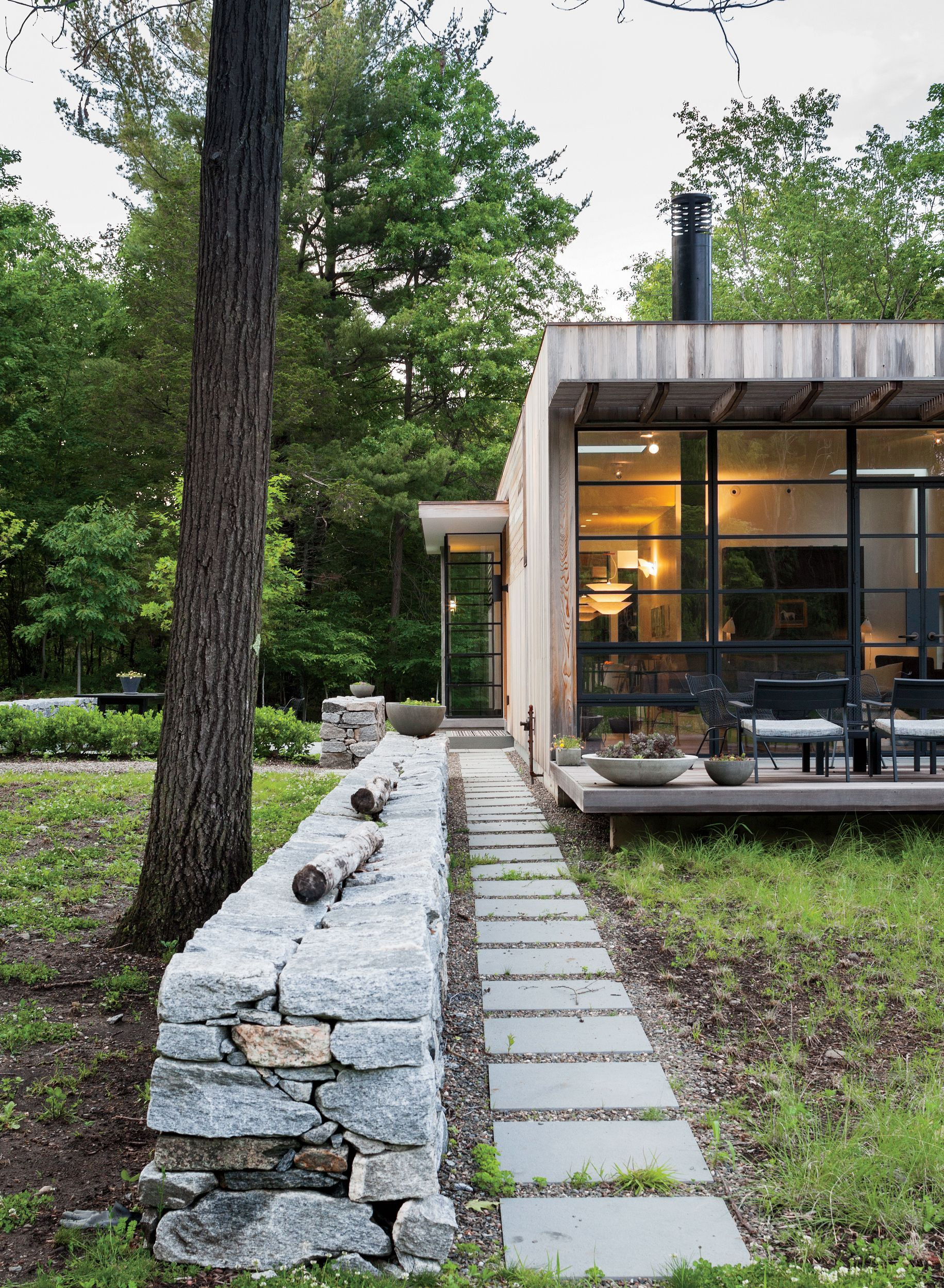 Upstate new york small sustainable retreat for chilewich and sultan outdoor stone wall facade