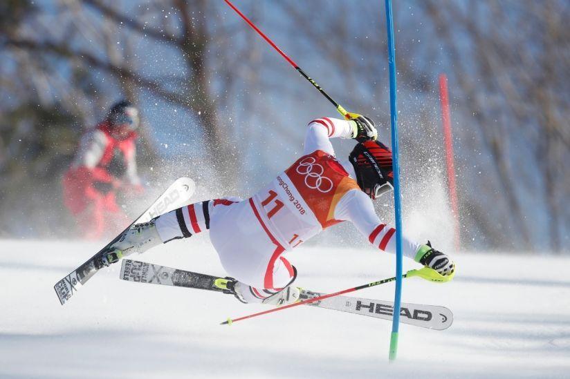 Matthias Mayer of Austria crashes during the men's alpine