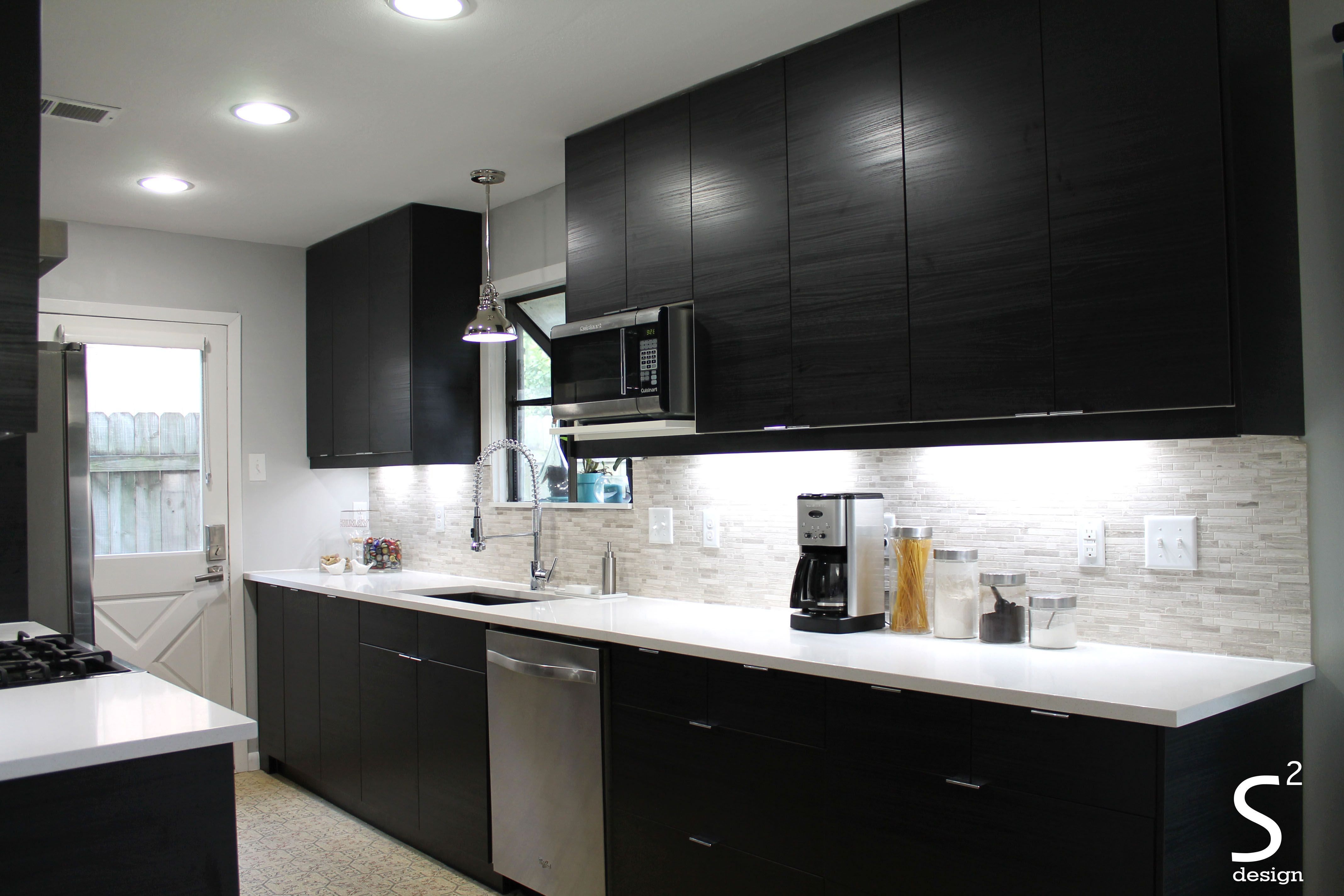 Modern Kitchen Black Cabinets White Quartz Counters Stainless