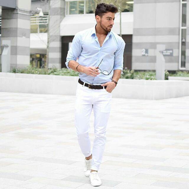 Light blue shirt, white pants, black belt, white shoes