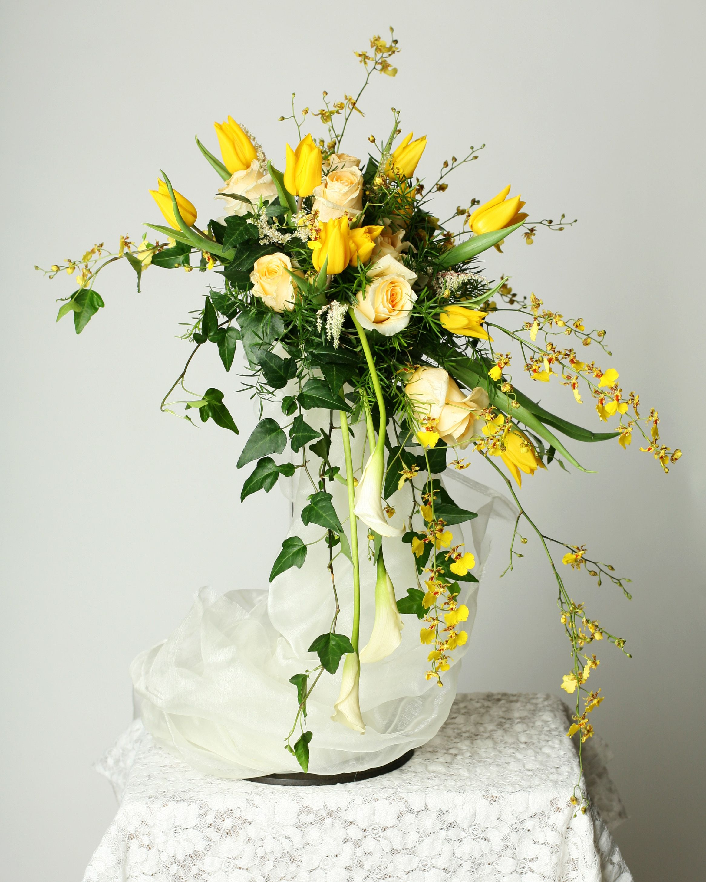 Cascade Bridal Bouquet With Oncidium Orchids Yellow Tulips Cream