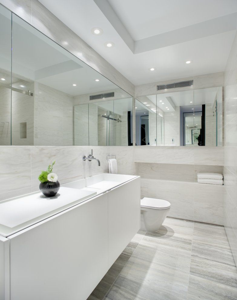 Pictures - UN Plaza, New York, NY - Architizer. Satunnainen bathroom design with mirrors and tiles.