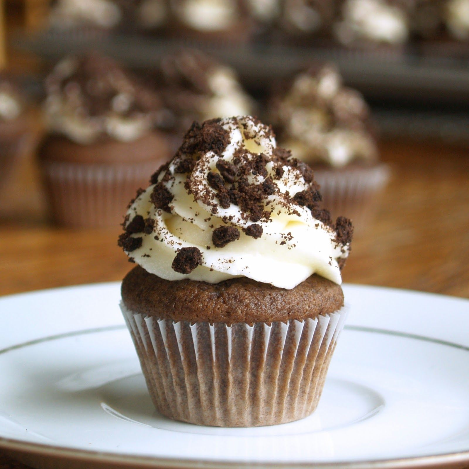 Indulge your sweet tooth with these chocolate cupcakes topped with oreo filling frosting and oreo cookie pieces. Can you say yum?!