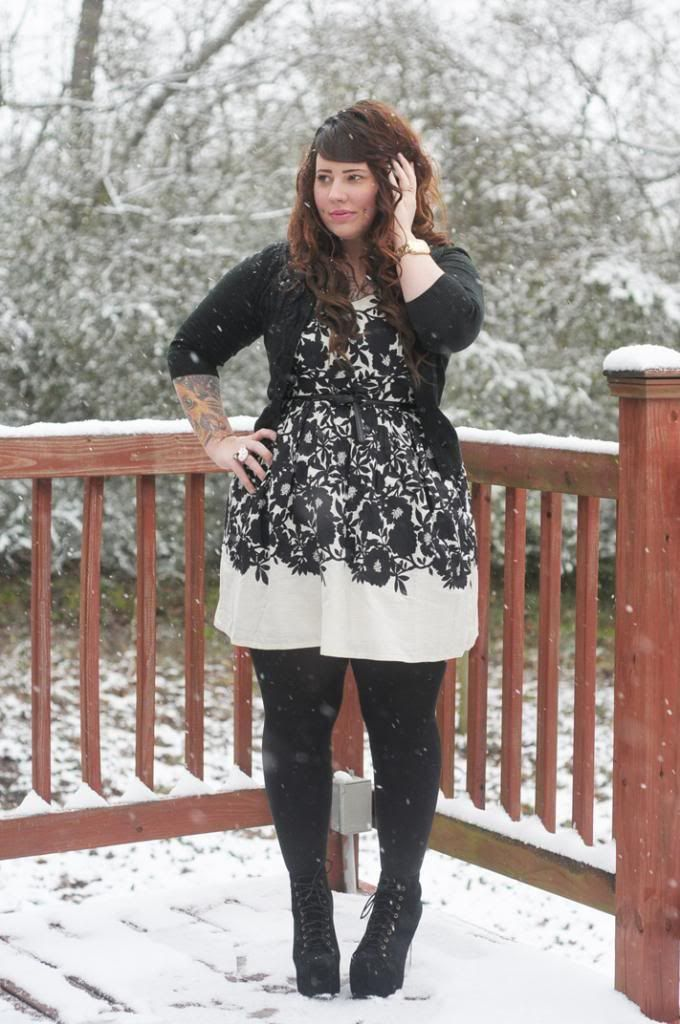 Black and white skater dress with short sweater, black tights and ...