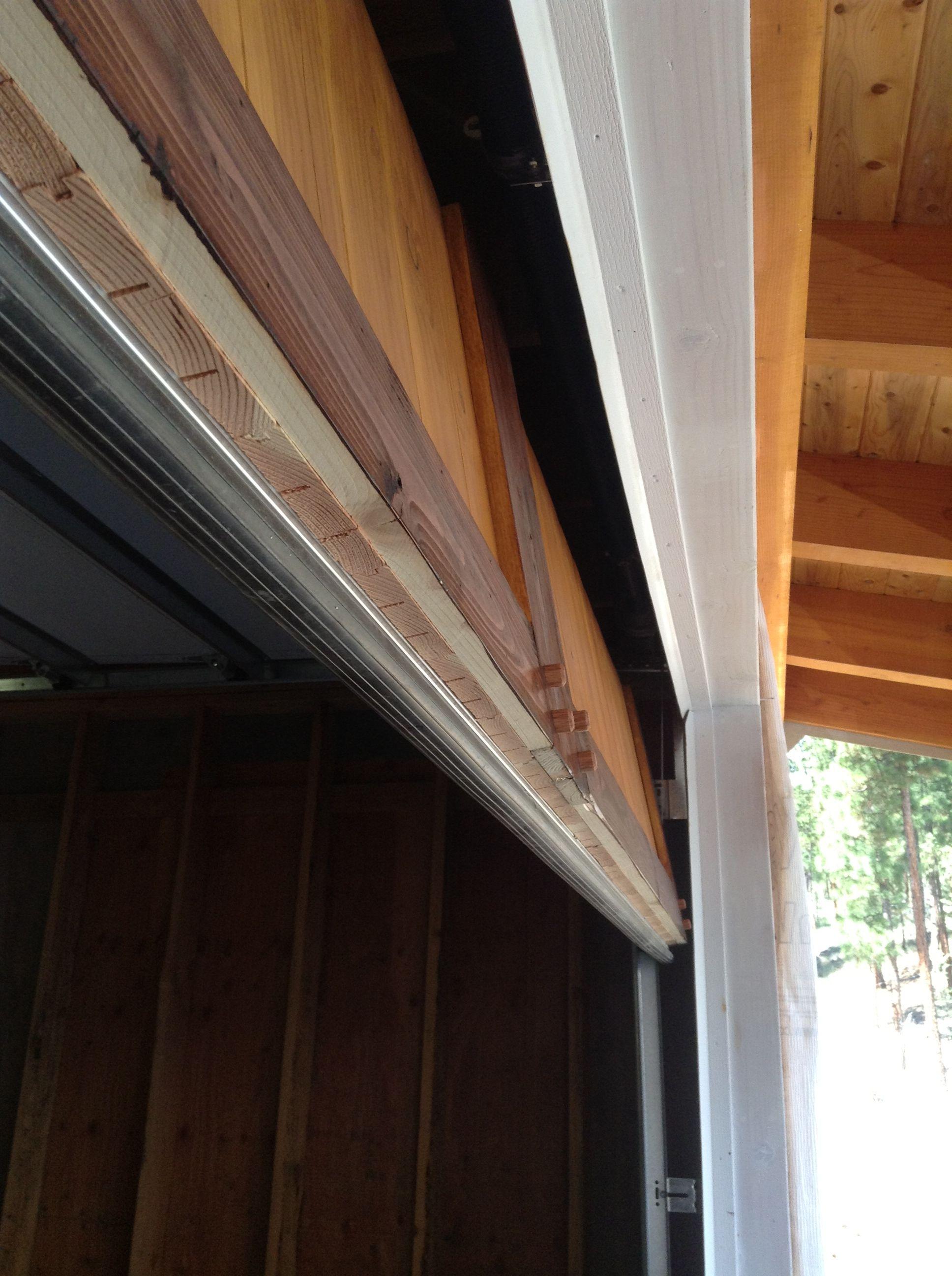 Under Side Detail Showing Rubber Weather Strip On Bottom Of Metal Door With 2 3 4 Wood Overlay Metal Door Roll Up Garage Door Sectional Door
