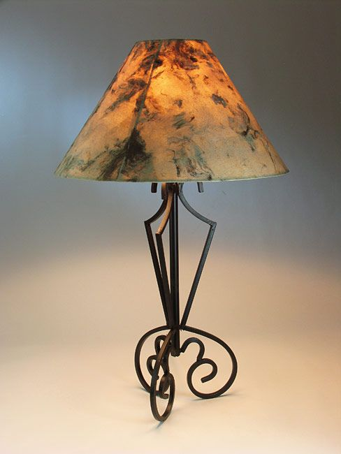 Tri base iron table lamp with cream bark paper shade farm this rustic iron tri base table lamp comes with a hand crafted bark paper shade distinctive angles and scrolls on the iron base give this lamp a unique aloadofball Images