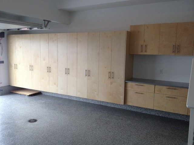 Attractive Modern Garage And Shed With Sleek Marble Floor Wood Cabinets Cool Stainless Steel S