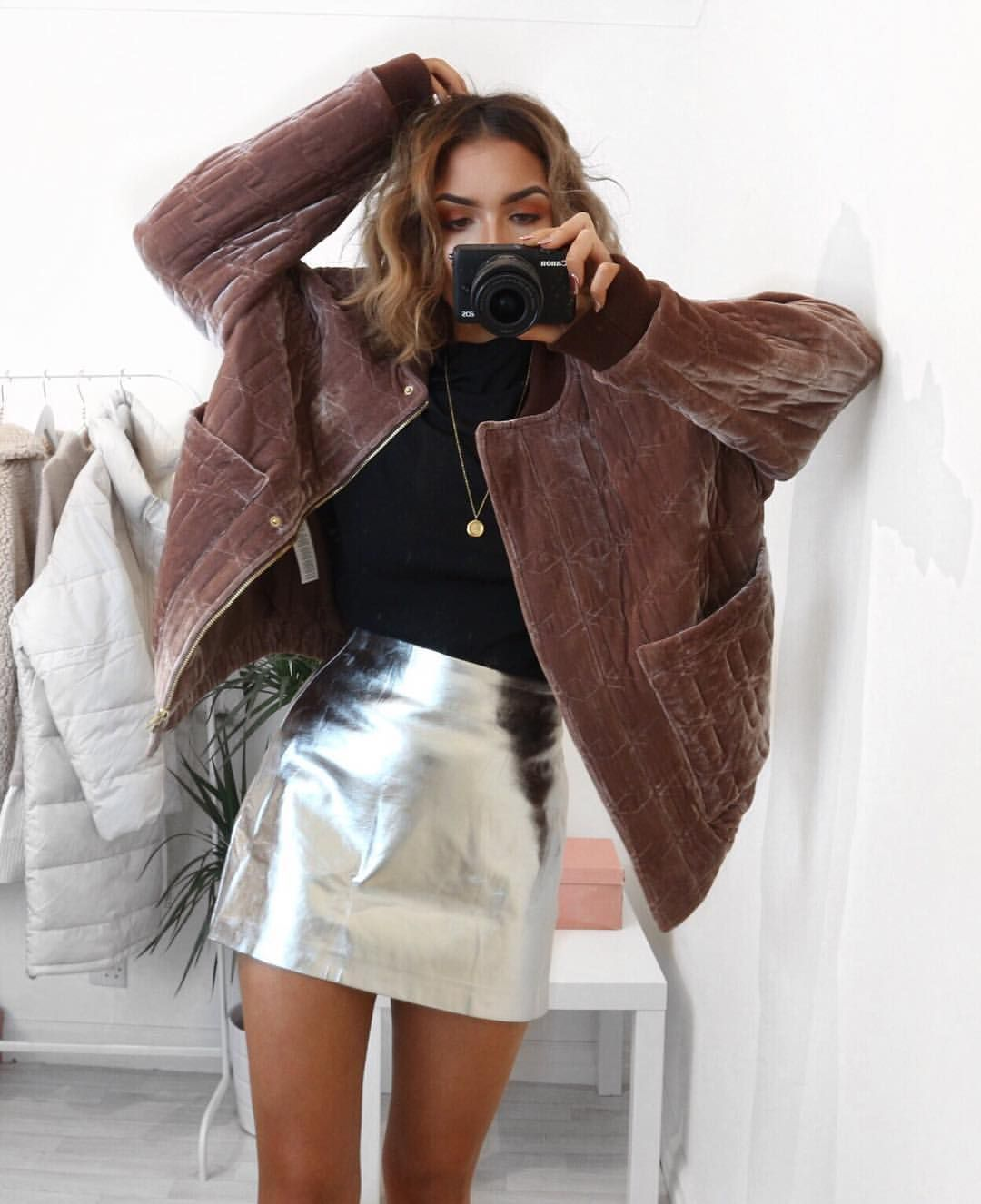 0db0484a48 Mix textures for a luxe holiday outfit, like this high shine metallic  miniskirt and fuzzy faux fur jacket