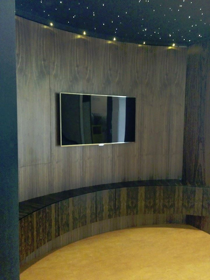 Ziricote Veneered Curved Lower Cabinet To Conceal The AV Equipment With  Walnut Panelling Above To House