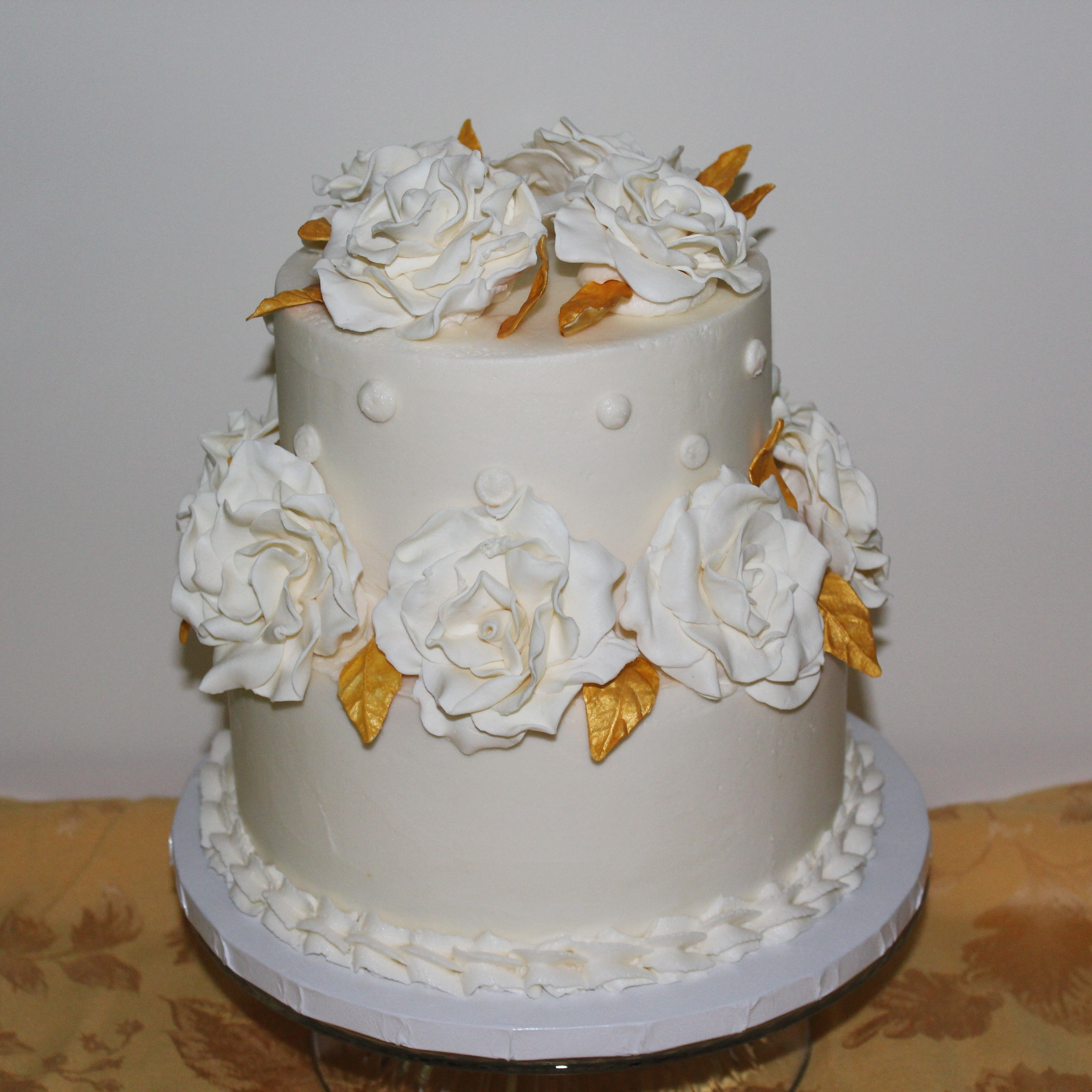 White modeling chocolate roses for a 2 tier 50th Anniversary cake ...
