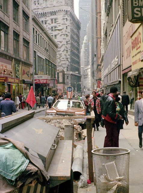 """retronewyork:  Nassau Steet looking toward Wall Street in 1976. Street life and a BIG 1975 Cadillac.  New York by wavz13 on Flickr.  """