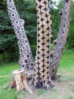 British artist Stuart Frost breathes new life into dead trees by transforming raw organic materials using a process he developed of pyrography. Intricate patterns, loosely based on 19th century wallpaper motifs, are defined by scorching the surfaces of dead trees