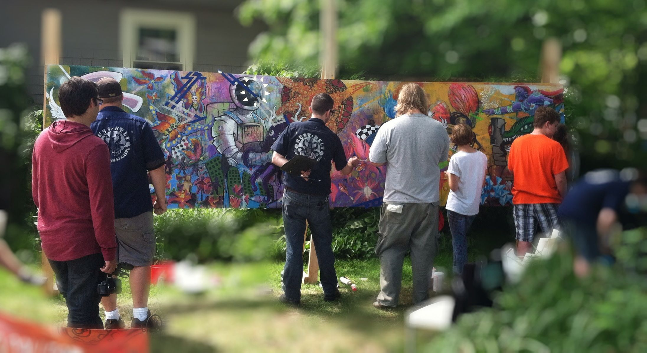 Rust Belt Monster Collective painting mural at Art & Music Festival, June 15, 2013