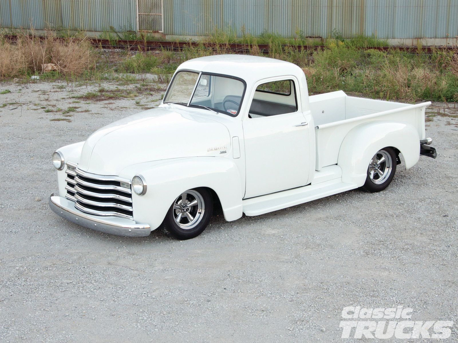 1302clt 11 O 1955 Ford F 100 Vs 1950 Chevrolet Pickup Front
