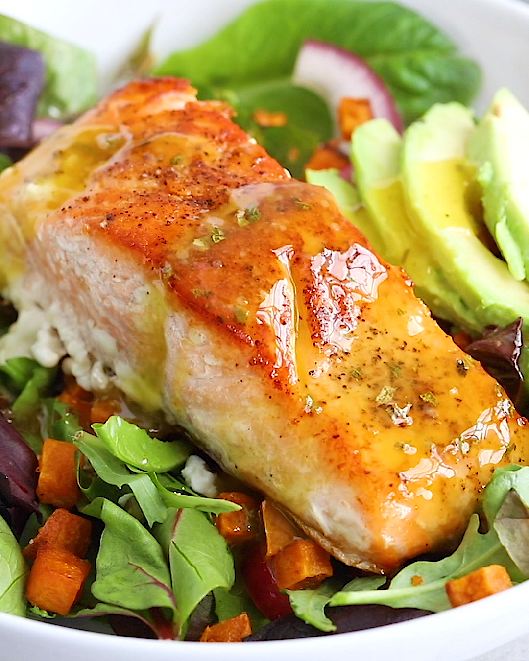 This salmon salad is loaded with roasted sweet potato croutons, avocado, pickled onions and dressed in a light lemon vinaigrette! It's an easy go-to meal you'll love having as part of your weekly rotation.