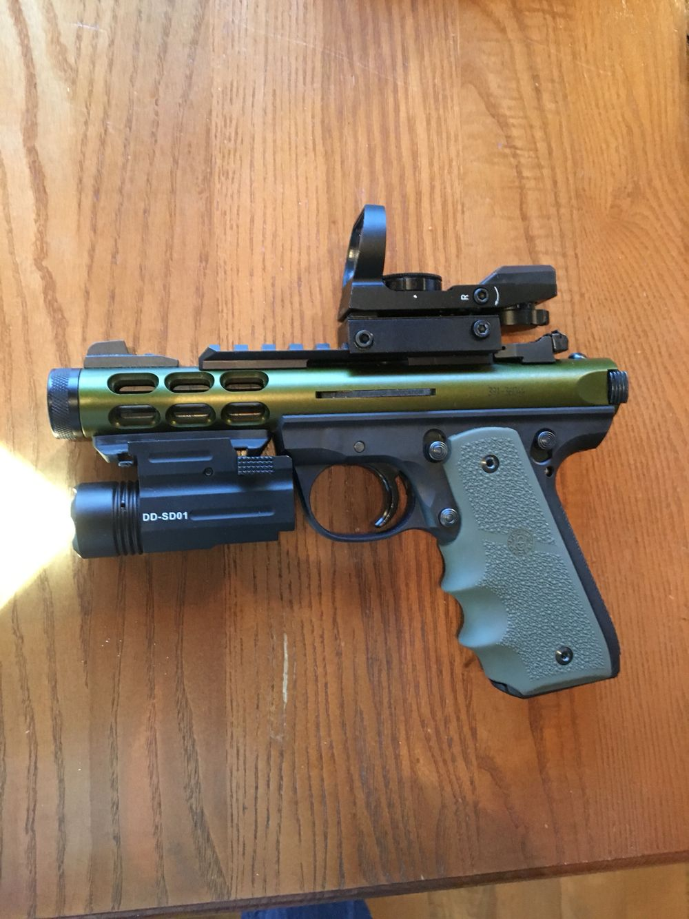 My 22/45 Lite Ruger with Hogue grips, red dot sight and