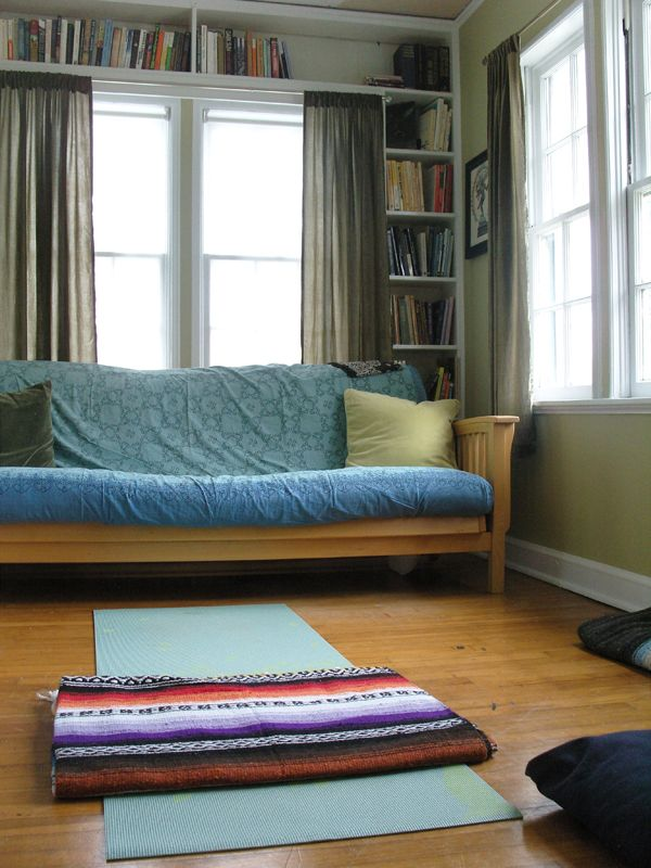 One bedroom gets to be a library/yoga studio/office/playroom. Love ...