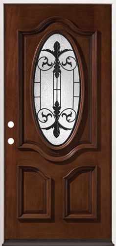 Oval Mahogany Wood Entry Door With Internal Iron Grille.