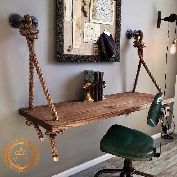 Unique and industrial, this beauty has been created to serve not only your functional needs, but your aesthetic needs as well. It is finished with a 1 knotted rope suspension which is anchored to the wall with heavy iron pipe brackets. The ends of the knotted ropes have been capped off with beautiful, solid copper caps. This desk is not only sturdy, it has a one-of-a-kind design and offers the perfect amount of working space! The wood portion is made of 2 solid pieces of wood. We believe…