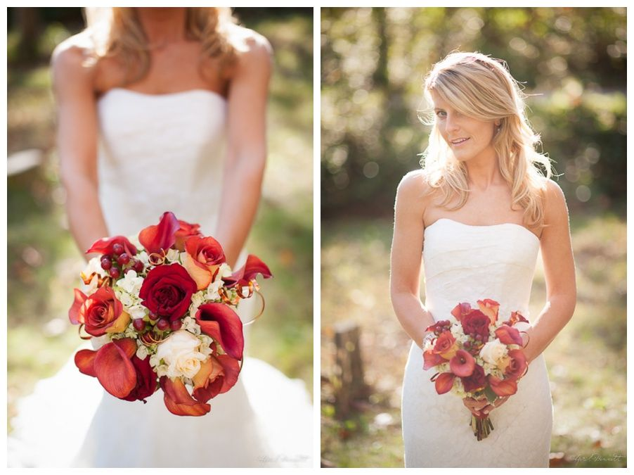 Fall wedding bouquet: burnt orange lilies, red roses, copper twirls, pale pink roses. - April Bennett Photography, Charlottesville.