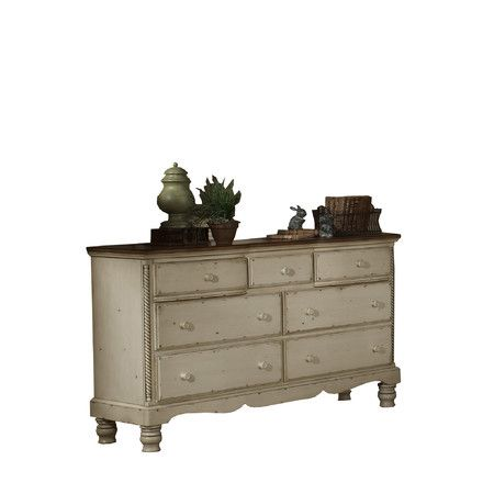 Crafted of New Zealand pine wood, this charming dresser ...