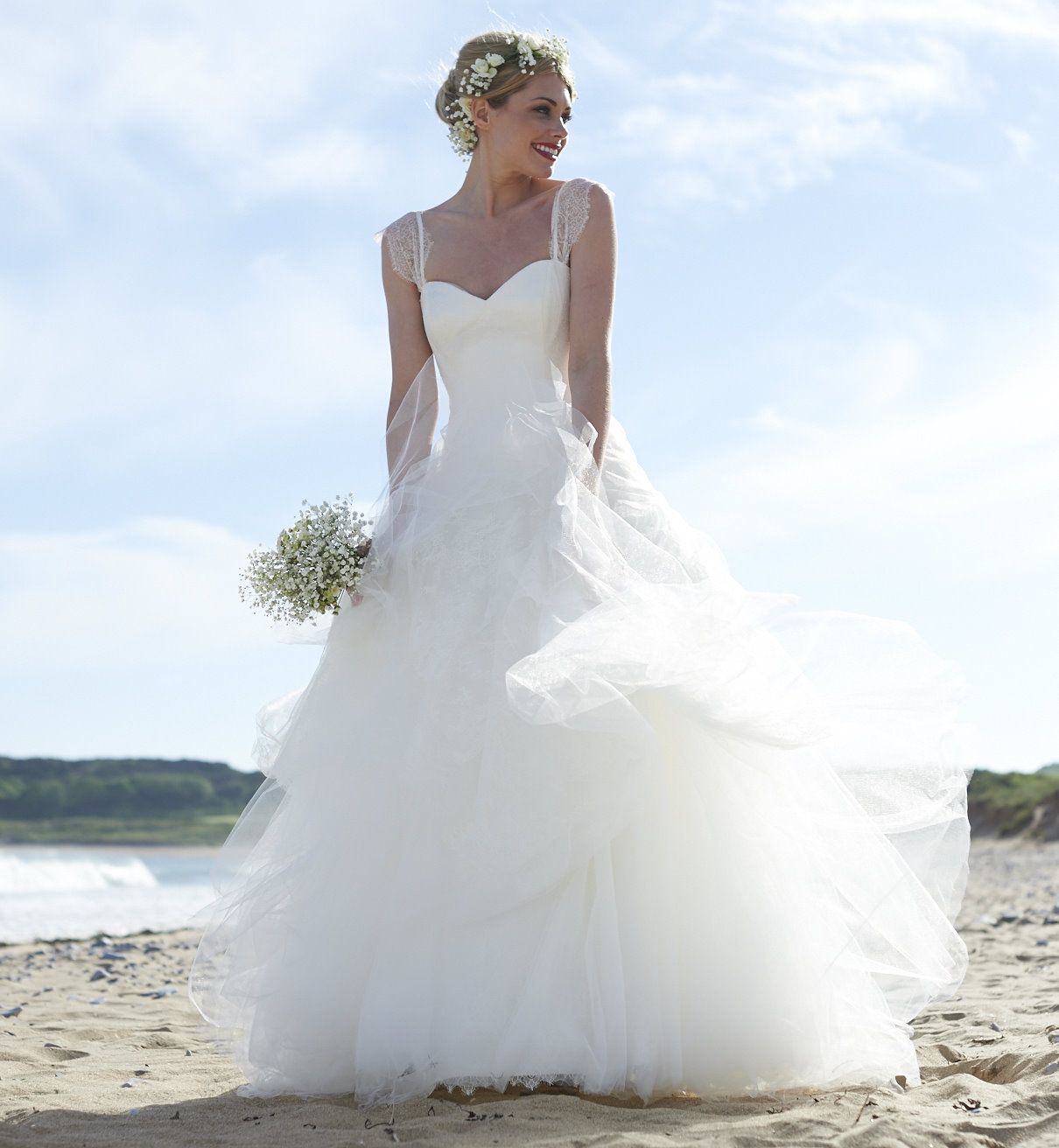 A relaxed boho inspired dropped waist bridal gown with a very full ...