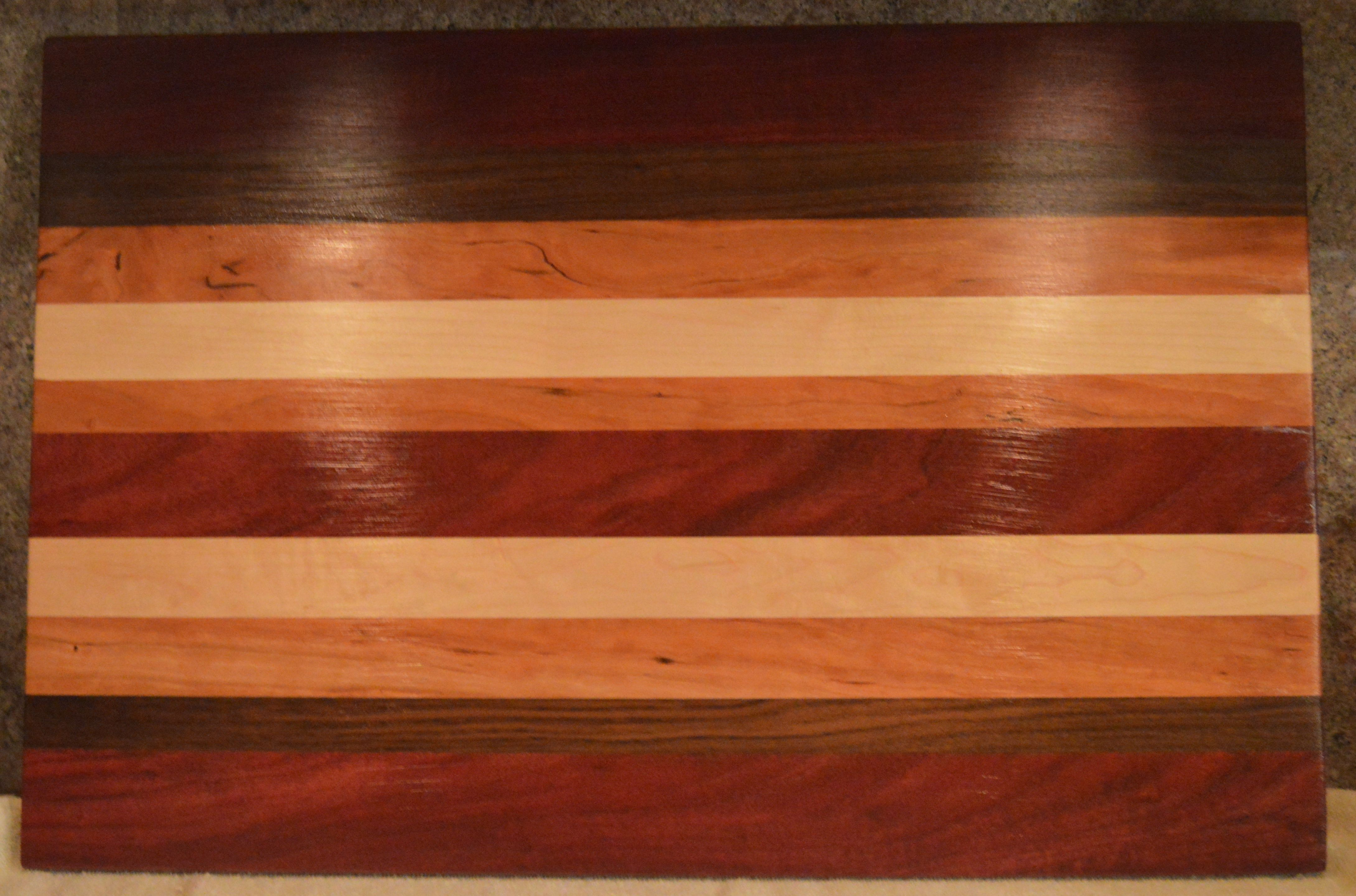 Hand crafted by your's truly wood cutting board. Made of purple heart, walnut, cherry and maple.