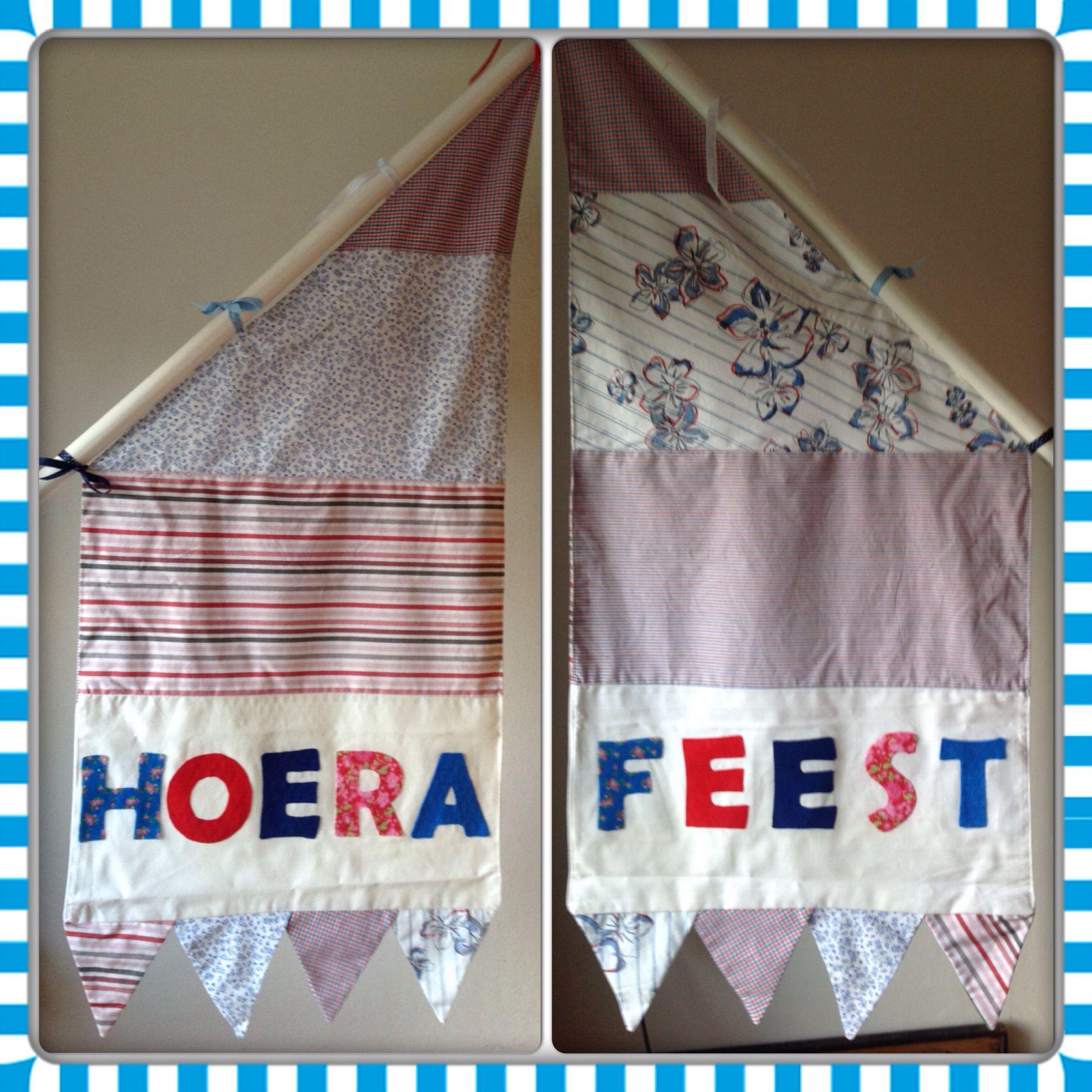 Feestvlag gemaakt van oude overhemden en vilt.