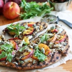 A beautiful combination of flavors, including grilled peaches, blue cheese, toasted walnuts, fresh sage, arugula and a drizzle of balsamic