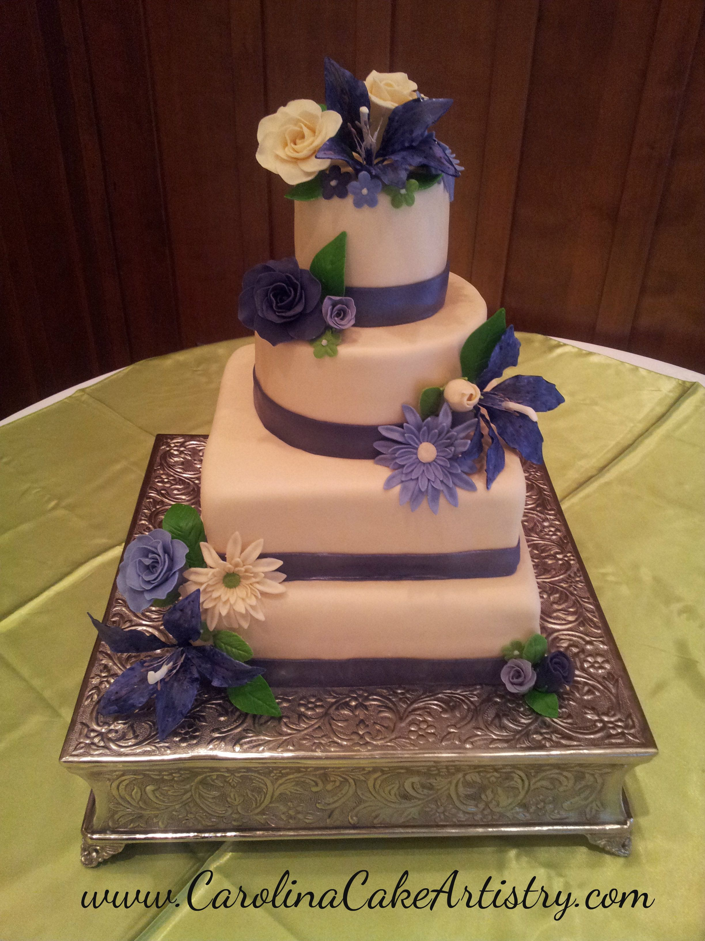 round wedding cakes with purple flowers and square wedding cake with purple flowers 19338