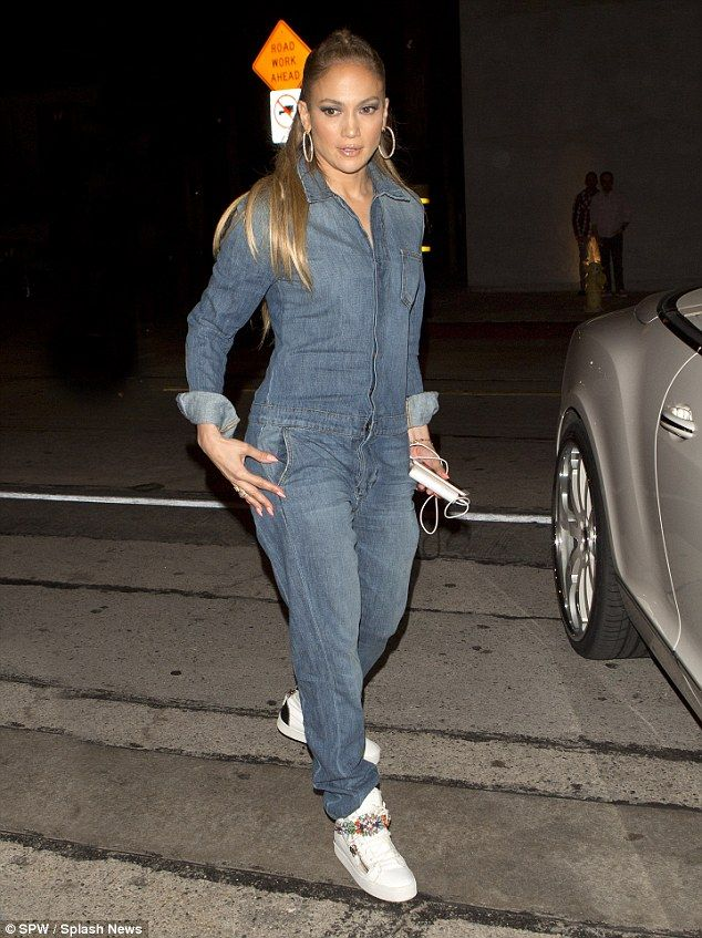 Sporty and sexy: Jennifer Lopez donned a faded denim jumpsuit to go to dinner at Craig's R...
