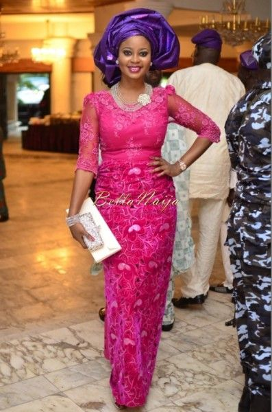 b9e28eb1bd6 Nigerian wedding guest in Pink Iro and Buba Lace and Purple Gele. Aso-ebi  styles.