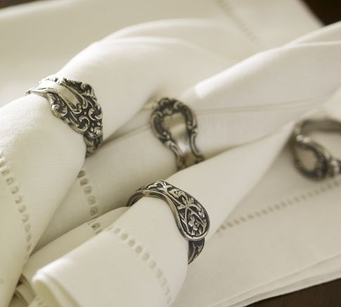 These napkin rings resemble antique Victorian flatware handles. Molded into a round shape that highlights their vintage designs, they are finished in antique silver. $16.00