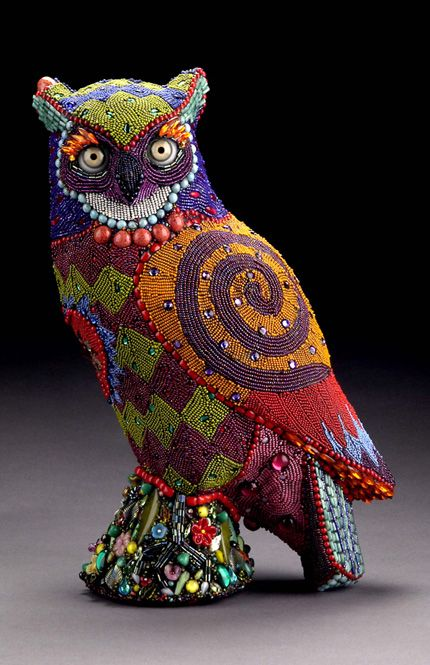Besty Youngquist builds wonderful anthropomorphic sculptures with contemporary and antique beads from around the world and vintage porcelain doll parts and prosthetic glass eyes. All her things are extra unusual and unique. Must see