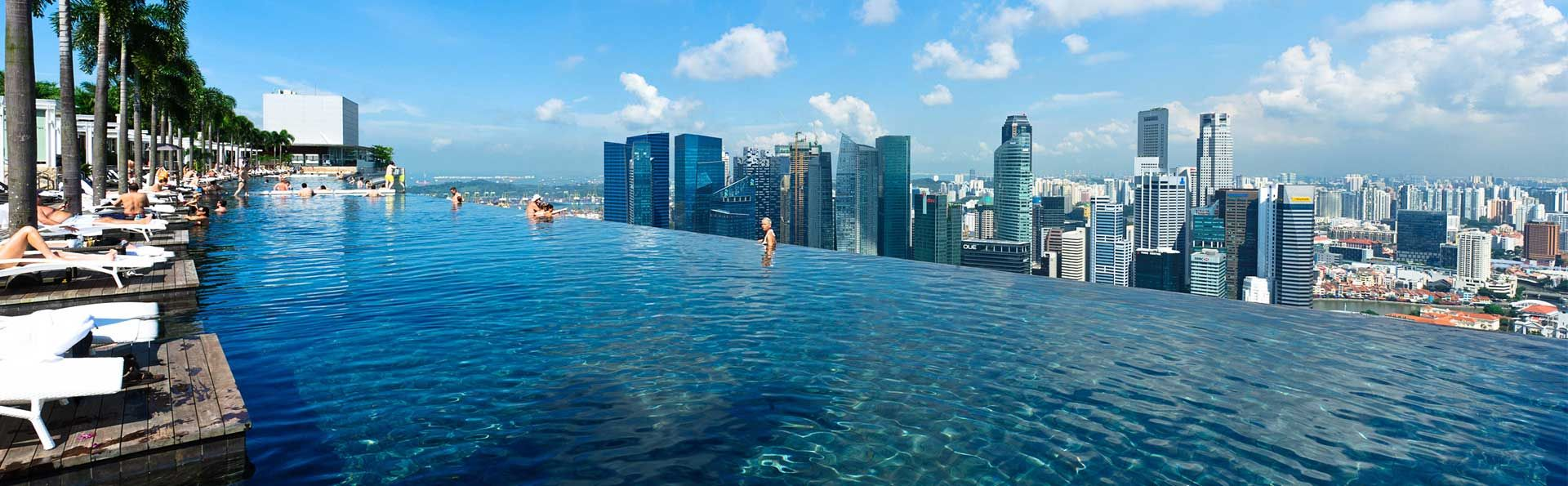 Infinity Pool At Rooftop Of Marina Bay Sands With View Of